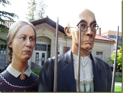 A close up of the man and woman faces.  Their detail and life like look is impressive.