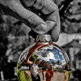 Two Hanging! by Jesus Giraldo - Artistic Objects Glass ( reflection, ball, girl, park, glass, spring, persons, man, city )