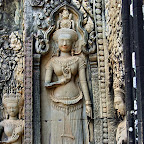 Thommanon - An exquisite devata (sacred female image) with pleated sampot (skirt) in fine detail. Note that her left and right hand grip flower stems with the distinctive devata mudra using the ring and middle fingers while the index and small finger are extended. Siem Reap, Cambodia http://www.Devata.org