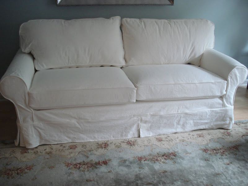 white slipcpvered sofa