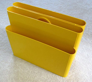 Kartell Stoppino 4676 magazine rack, yellow