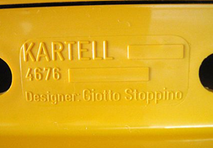 Kartell Stoppino 4676 magazine rack, yellow imprint