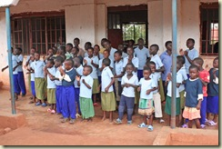 Tumaini children singing to visitors