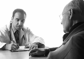 Photo of a man consulting his doctor