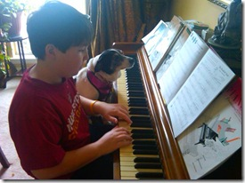 boy-and-dog-practising-piano