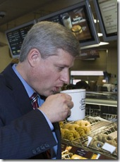Prime Minister Stephen Harper takes a sip of his hot chocolate while visiting a Tim Horton's in Oakville, Ontario on Wednesday September 23, 2009. THE CANADIAN PRESS/Frank Gunn