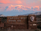 Capitol Reef National Park sign with Henry Mountain in the background