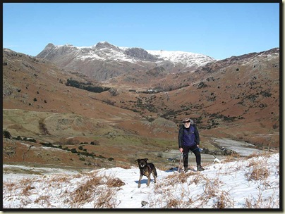 Mike on Birk Fell, showing off his new buff, with the Langdales behind