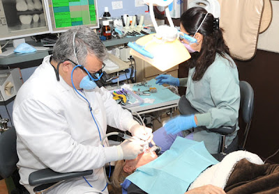 beverly hills cosmetic dentist dr. zadeh performing surgery