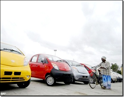 tata nano s lined up man with cycle looking hyderabad