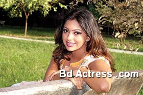 Bd Actress Nipun sitting on a chair