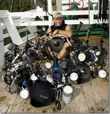 photographer Stephen Frink with array of Seacam housings during photo safari to Raja Ampat.