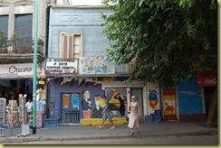 Lady crossing street in La Boca