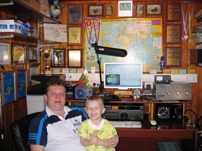 Alex Sukharev in his shack with his boy.