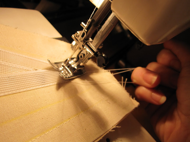 Hold on to the threads at the end of each line to make sure they do not get tangled.