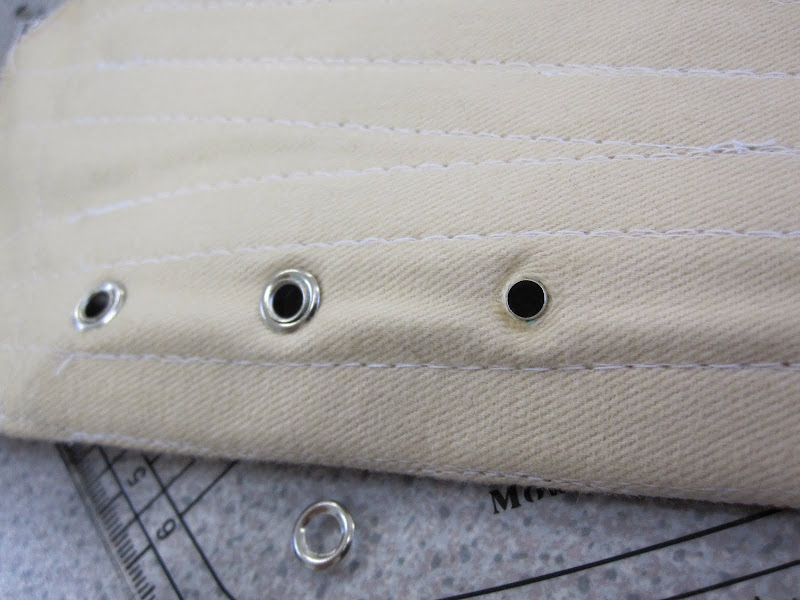 Eyelet through the hole, ready for the washer to be crimped on.