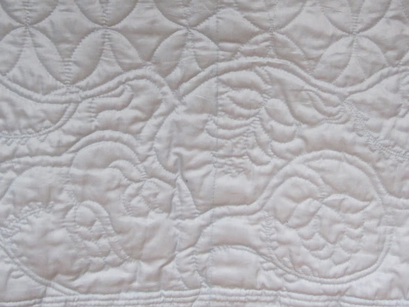 Bottom border 'Trunk' at centre back of quilted petticoat
