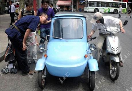 سكان شنغهاي سعيدون بالسيارة الكهربائية