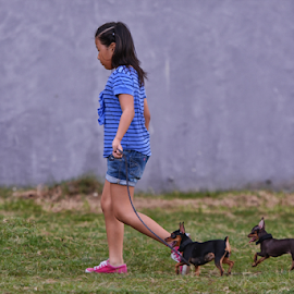 walk with me by Ferdinand Ludo - Babies & Children Children Candids ( child walking with dog, doberman pincher, dog show )