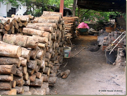 stacks of rubber tree logs