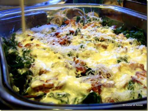 pouring cream on winter greens gratin