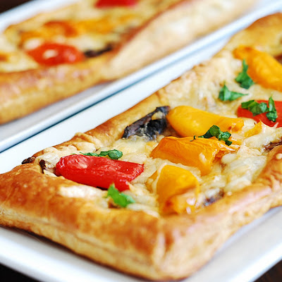 Puff pastry pizza with bell peppers, mushrooms, Mozzarella and Parmesan cheese