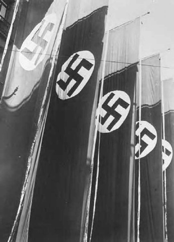 Enormous vertical red banners, at the time of a Nazi Party rally, Nuremberg, September 1934, seen in Leni RifenstahVs propaganda film Triumph of the Will.