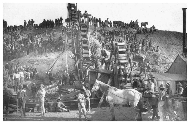 Nineteenth-Century Diamond Miners in South Africa. Laborers stand amid machinery for washing diamonds at the Bultfontein Diamond Mine near Kimberley, South Africa, in 1888.