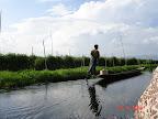 One legged canoe rowing
