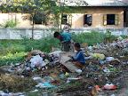 Kids looking in trash