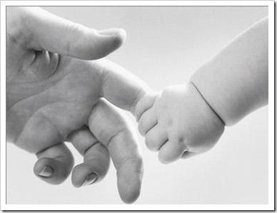 mão de pai e filho
