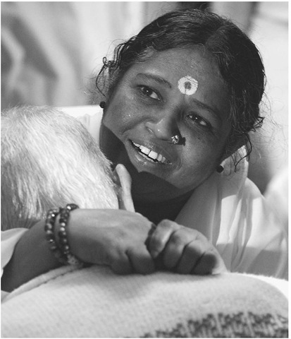 Mata Amritanandamayi Devi, widely known as Amma the Hugging Saint, spends up to twenty hours a day hugging and speaking with people all over the world.