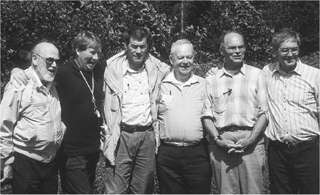 Harold Williams (third from left in open jacket), flanked by John Dewey (left) and James Skehan, S.J. (right), on a field conference in 1994