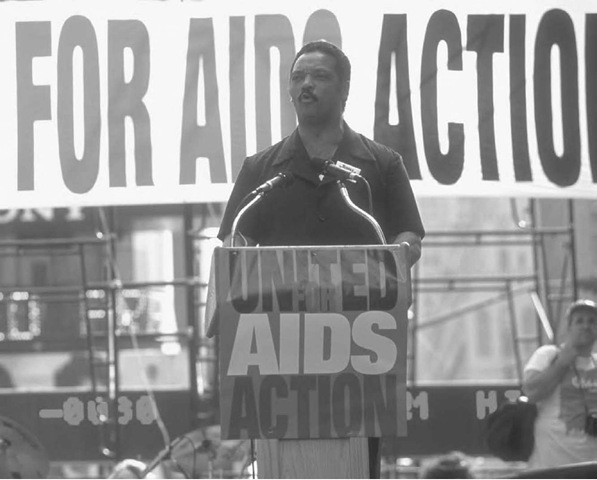 Jesse Jackson, leader of the Rainbow Coalition, speaks at a United for AIDS Action demonstration in New York City. Fifty thousand people turned out for the 1992 event in Times Square.