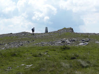Approaching the trig point at Carreg Yr Ogof. (Llanddeusant, United Kingdom) Photo