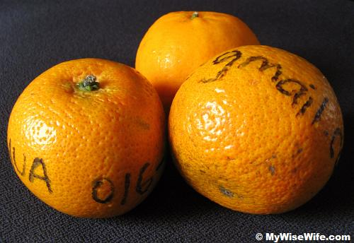 Tangerines are written with name and contact number