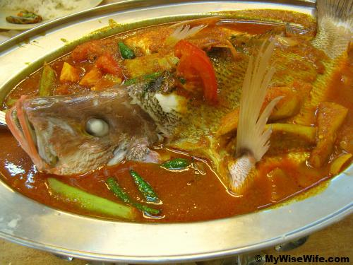 Huge fish in curry and some assorted vegetables
