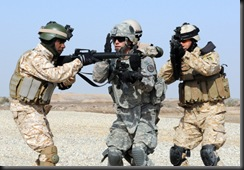 WASIT, Iraq – A Soldier from Battery L, 2nd Squadron, 3rd Armored Cavalry Regiment, leads Iraqi Army Soldiers in a squad drill on Contingency Operating Base Delta Wednesday. Lion Battery is working with local IA on basic squad and platoon level exercises to improve their cohesion and readiness. US Army photo by Staff Sgt. Garrett Ralston (110216-A-8856R-001)