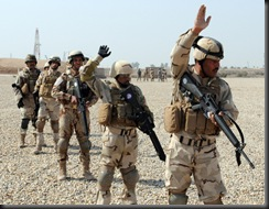WASIT, Iraq – An Iraqi Army Soldier gives a hand signal to move his squad forward during a training exercise held on Contingency Operating Base Delta Wednesday. Soldiers of Battery L, 2nd Squadron, 3rd Armored Cavalry Regiment, provided assistance in training the IA on basic squad and platoon level skills. Lion battery Soldiers are scheduled to spend a week training their Iraqi partners. US Army photo by Staff Sgt. Garrett Ralston (110216-A-8856R-004)