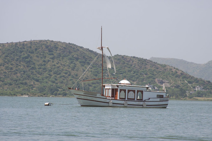 A single luxury boat moored in the middle of the Pichola Lake in Udaipur - from the look, this seems like a boat meant for high end customers