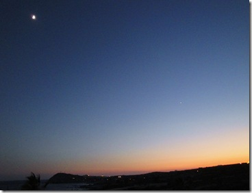 16.  Moon, planet, sunset