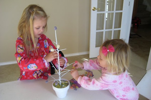 Kids decorating a Gum Drop Tree