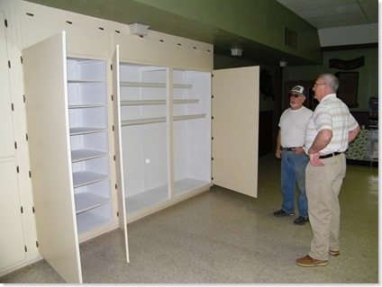 George Reid showing Don the cabinets he built at SA SOWERS project.