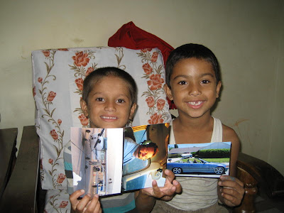 Ashis and Sudip with the photos I sent. In this shot, taken two years ago when I first met them, Ashish  and Sudip were both seven years old.