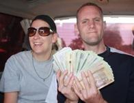Shawn fanning a load of Ugandan money