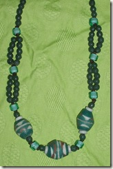green ceramic necklace detail