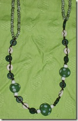 green polka dot necklace detail
