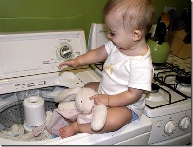 Elaine 8 months washing bunny