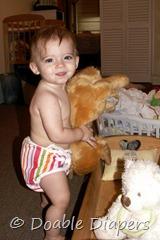 Elaine 10 months with Samson in cradle