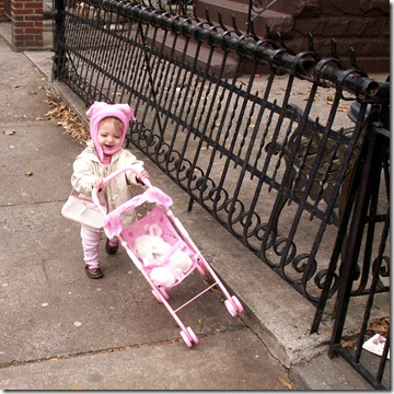 Elaine pushing the dolly stroller outside